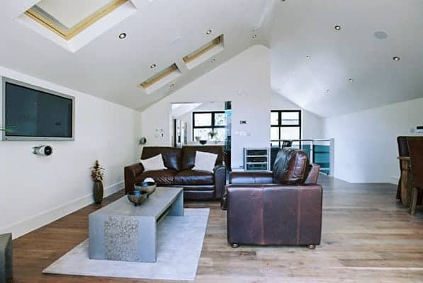 loft conversions earlsfield - brown leather sofas